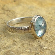 abed96593b199 Ornate sterling ring with blue aquamarine cabochon (Etsy  maximeboldeau). I  so love this xoxo