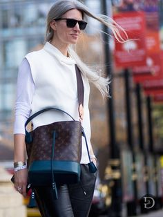 minimal white & a fab bag. #SarahHarris looking fly in London.