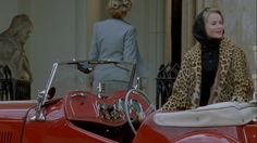 Lucy shortly after arriving at Rutherford Hall in her red convertible. I love her leopard print coat, driving gloves, black scarf to protect her hair.