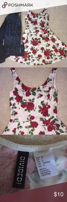 Divided by H&M Red, White, and Green Floral Skater This dress is perfect for any occasion! Skater dresses are great on their own in the summer, or under layers in the winter. In like-new condition. Marked size 6, but stretchy enough to fit any small, and listed as such. Jacket in picture also available in my closet. Comment with any questions—and don't forget the bundle discount! Divided Dresses Mini