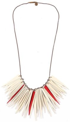 white + red leather strip necklace.