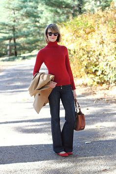 Break out a bright turtleneck with a pair of dark, flared jeans and a camel coat.