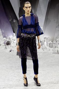 love the layering, rhinestone belt (very vintage!), and beautiful blue... Chanel.