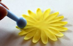 Tutorial: How to make a sunflower from fondant / gumpaste. You can use the flower to decorate fondant cakes, cup cakes, wedding cakes etc.