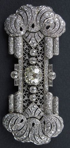 An Art Deco platinum and diamond brooch, French, circa 1920. #ArtDeco #brooch #DiamondBrooches