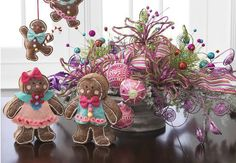 RAZ floral arrangements using Gingerbread, candy striped ribbon, sprays and pink glittered balls from the Candy Wonderland Collection