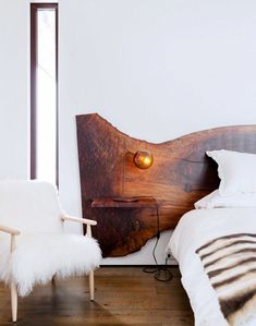 Wood slab headboard and furry side chair