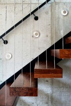 Detailed photo of cables supporting treads and forming balustrade. Via Arch Daily