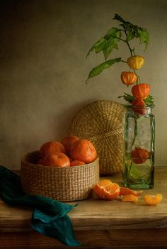 Sophisticated Chinese Lanterns in perfect harmony with mandarin oranges.