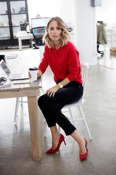Picture Of a red cashmere sweater, black cropped jeans, red heels for a Friday look at work