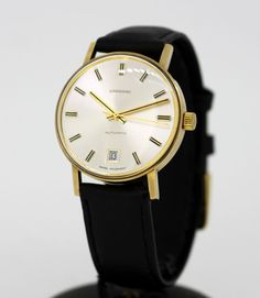 Currently at the #Catawiki auctions: Garrard 9K Yellow Gold Automatic Swiss Made Wristwatch, London 1996
