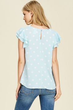 Ruffles and polka dots, two of our favorites! Sneak peek! This light blue top will be available soon.