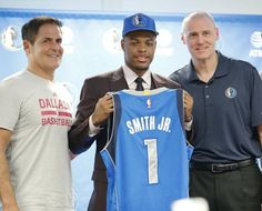 Dallas Mavericks first-round draft pick Dennis Smith Jr. will wear jersey No. 1 for owner Mark Cuban, left, and coach Rick Carlisle.