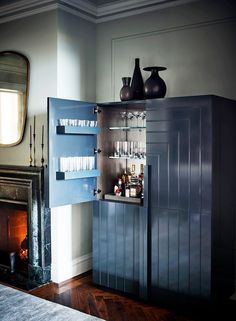 Whether or not you miss crowded bars, it's safe to say that being able to fix yourself a drink at home, whether it's an alcoholic beverage or not, has become increasingly important. You don't need to have a full-blown bar setup—custom counter builds, stools, the works—to have a stylish and functional home bar. head, discover creative small-space solutions from some of our favorite designers to have the home (mini)bar of your happy hour dreams, no matter your square-footage restrictions. Loft Spaces, Small Spaces, Small Bars For Home, Bar Unit, Slanted Ceiling, Bar Set Up, Small Space Solutions, Dutch Door, Cabinet Design