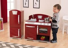 Welcome the Holidays with the Retro Cranberry Kitchen by KidKraft. Durable and solid to last for many years, kids can wipe up a bit to eat or wash their dishes. Imaginary play at its best.  http://www.sensoryedge.com/kidkraft-cranberry-retro-kitchen-refrigerator.html