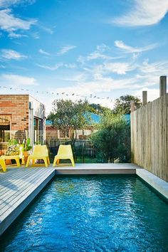 You need to see this gorgeous Australian home renovation featuring a mix of Scandinavian and Global-inspired design: we love the serene feel of this gorgeous pool, whitewashed deck and yellow molded patio furniture. Outdoor Fun, Outdoor Spaces, Outdoor Living, Outdoor Decor, Outdoor Paint, Outdoor Life, Swimming Pool Designs, Swimming Pools, Moderne Pools