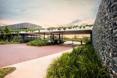 Image 14 of 21 from gallery of The Gates / Bloc Architects. Photograph by Chris Allan Meaning Of Community, Planet Coaster, Co Housing, Entry Gates, Outside World, Gated Community, Sustainable Living, Water Features, Natural Stones