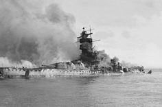 The German battleship Admiral Graf Spee in flames after being scuttled in the River Plate Estuary off Montevideo Uruguay.