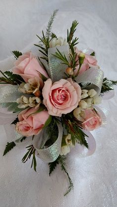 Pink spray roses and wax flower create a delicate look for this wrist corsage. www.facebook.com/fancyfloralsbynancy www.fancyfloralsbynancy.com