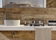 Love this new porcelain tile that looks and feels like wood