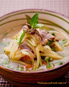 Green Mango and Beef Soup (Canh Xoài Xanh Thịt Bò) is known as one of stunning Vietnamese Soup Recipes . The combination if green mango w. Easy Vietnamese Recipes, Vietnamese Soup, Vietnamese Cuisine, Asian Recipes, Ethnic Recipes, Beef Soup Recipes, Marinated Beef, Sour Taste, Asian Soup