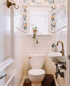 Small wallpapered powder room