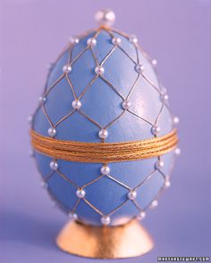 Pearl Trellis Egg  gluing 12 strands of gold thread to the top of an egg, then threading a pearl on two strands at a time. Glue each pearl as you go, keeping the spacing even. MS