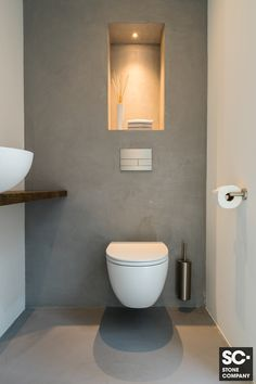 Storage over toiletStorage over toilet ideas for the smallest room in the house!Toilet Inspiration Trend ColorToilet room The Hague (Stone Company)Nice slim toilet with a concrete circle. The toilet and the fountain are matt Small Toilet Design, Small Toilet Room, New Toilet, Bathroom Design Small, Bathroom Interior Design, Bathroom Styling, Modern Bathroom, Modern Toilet Design, Bad Styling