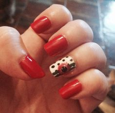Red nails with polka dot and flower accent inspired by another pinner