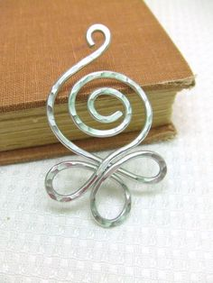 Filigree Spiral Pendant Aluminum Pendant Wire Wrap Pendant Hammered Metal Pendant Jewelry Gifts Under 20 Artisan Handmade. $14.95, via Etsy.