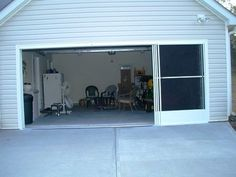pin 1 of 2 pics- A got to have ! - Garage Door Screen Panels slide open  horizontally ...1 at a time, so great, a in/out door while working in the yard or wider to move equipment !http://www.ezebreeze.com/garage-door-screen-panels  - I have seen the remote roll up,garage screens, they took so long to open, close plus the whole span had to open.