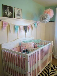 Pink and Blue Nursery...I love the bunting and wainscoting with the blue wall.