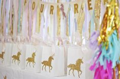 """White and gold favor bags from a Magical """"Magic is Four Real"""" Unicorn Birthday Party at Kara's Party Ideas."""