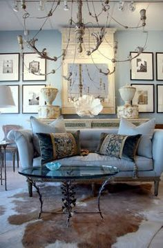 I want to lay on that rug in front of my fireplace with my head on one of those velvet pillows, marveling at how lucky I am to have that chandelier.  This arrangement and many more are on Artsy Annie's blog.