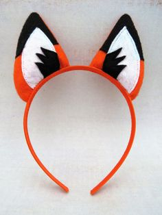 Woodland fox ears for dress-up play or to add to a costume. The ears are made from orange felt and are firmly stitched to a satin covered headband. Will fit most children and adults (not toddlers or babies). Please spot wash only.  Height of ears is approximately 3 (7.6 cm) and width of headband is 3/8 (9.7 cm)   --------------------------------------------------------------------- Ships from Canada.  SHIPPING INFO:  In order to keep shipping charges as low as possible I ship mostly via…