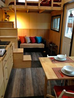 The interior consist of two tone bamboo wall panels, pine tongue and groove ceiling, and vinyl flooring.