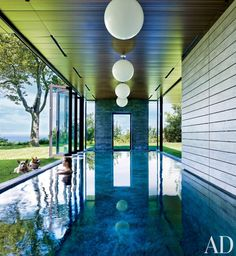 This New York country house, spotted on Architectural Digest, has folding glass doors that open it up the outside when the weather is nice.