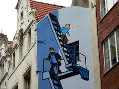 A painting on a building in Brussels // Tintin, Haddock, and Snowy