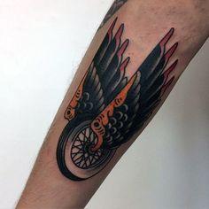 Traditional Angel Wings With Wheel Male Biker Tattoo On Forearm