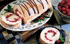 Strawberries and Cream Angel Food Cake Roll  1 package angel food cake mix, ½ cup confectioners' sugar, 8 oz whipping cream, ½ tsp vanilla extract, 3 TBsp sugar, 2 cups fresh berries, ⅓ cup chocolate chips (chopped), 1 TBsp butter (softened)