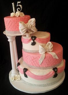 #Quinceanera cake | pink & black | bows | round cake | 4 tiers | Denver bakery | Azucar Bakery