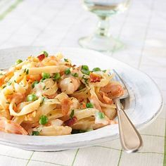 Creamy Fettuccine with Shrimp and Bacon | A dish of shrimp sautéed in bacon drippings and tossed with fettuccine sounds like a no-no for the calorie conscious. But at under 400 calories a serving, indulge!