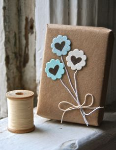Gift wrapping heart balloons