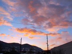 minus two/ orange and peach clouds dapple dawn/ utility poles creak #haiku