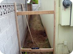 DIY Gate Tutorial-Do the same for the top and bottom. Cut the gate slats to the desired length and sand them so that they are ready for Paint.  I started at the far end to ensure a proper fit.  Now you are ready to attach the gate slats of wood.   I used a drill bit to space them evenly since the boards were a little warped.  Use 2 1 5/8″ wood screws on the top and bottom of the slat to ensure a tight hold.