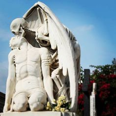 The 'Kiss of Death' statue at Poblenou Cemetery in Barcelona