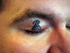 It appears as if this man is a big fan of the illuminati. #InkedMagazine #eyelid…