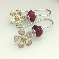 Silver daisy earrings with 18ct gold and rubies £38.00