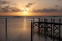 The sun sets behind some clouds over the water in Abaco, Bahamas. Download the photo without watermark @ www.kozzi.com or you can click the image.