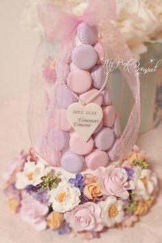 055//マカロンカラー:ピンク×パープル、ガーランド:花芯の見えるローズ、オレンジローズ、ピンク系ローズ、ライラック(アーティフィシャル)